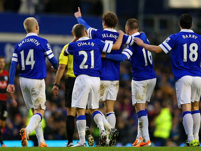 Everton's Nikica Jelavic celebrates with teammates after scoring his team's second goal against QPR during their FA Cup third round match on January 4, 2013