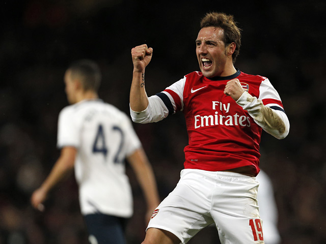 Arsenal's Santi Cazorla celebrates after scoring the opening goal against Tottenham during their FA Cup third round match on January 4, 2013