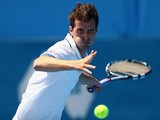 Albert Ramos of Spain plays a forehand in his qualifying match against Blaz Kavcic of Slovenia during day two of the Sydney International at Sydney Olympic Park Tennis Centre on January 6, 2014