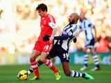 Jack Cork (L) of Southampton holds off the challenge of Nicolas Anelka (R) of West Bromwich Albion during the Barclays Premier League match on January 11, 2014