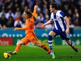 Luka Modric of Real Madrid CF duels for the ball with Alex of RCD Espanyol during the La Liga match on January 12, 2014