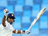 Sri Lankan batsman Mahela Jayawardene raises his bat in celebration after scoring a century (100 runs) during the second day of the second cricket Test match between Pakistan and Sri Lanka at the Dubai International Cricket Stadium in Dubai on January 9,