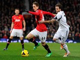 Manchester United's Belgian midfielder Adnan Januzaj vies with Swansea City's Spanish midfielder Jose Canas during the English Premier League football match between Manchester United and Swansea City at Old Trafford in Manchester, northwest England on Jan