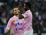 Evian's Modou Sougou celebrates after scoring the opening goal against Marseille during their Ligue 1 match on January 12, 2014
