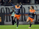 Montpellier's French forward Mbaye Niang reacts next to Montpellier's Benjamin Stambouli after scoring a goal during the French L1 football match Montpellier vs Monaco at Mosson stadium in Montpellier, southern France, on January 10, 2013