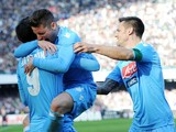 Dries Mertens of Napoli celebrates with team mates after scoring the opening goal during the Serie A match between SSC Napoli and UC Sampdoria at Stadio San Paolo on January 6, 2014