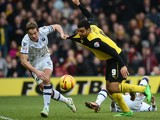 Troy Deeney of Watford has his shirt pulled by Paul Robinson Of Millwall FC during the Sky Bet Championship match between Watford and Millwall at Vicarage Road on December 26, 2013