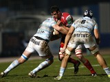 Scarlets' Welsh flanker Aaron Shingler challenges Racing Metro's Fijian flanker Sakiusa Matadigo and flanker Dan Lydiate during the European Cup rugby union match between Racing Metro and Scarlets at the Yves du Manoir stadium in Colombes on January 10, 2
