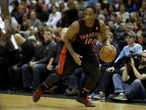 DeMar DeRozan #10 of the Toronto Raptors dribbles the basektball up the court during the game against the Milwaukee Bucks at Bradley Center on November 2, 2013