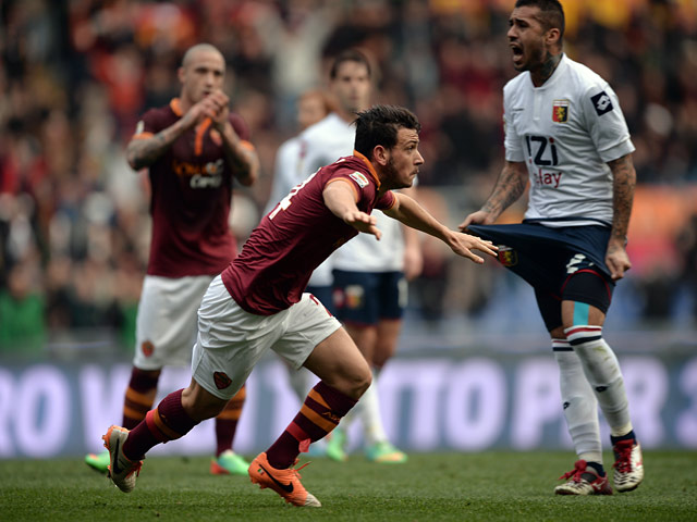 Roma's Alessandro Florenzi celebrates after scoring the opening goal against Genoa during their Serie A match on January 12, 2014