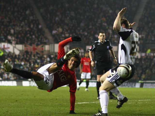 Carlos Tevez, then of Manchester United, attempts a shot against Derby County on January 07, 2009.