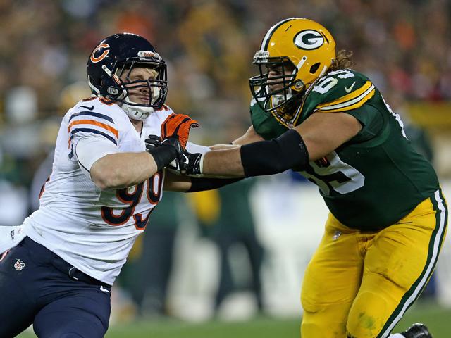 Shea McClellin #99 of the Chicago Bears rushes against David Bakhtiari #69 of the Green Bay Packers at Lambeau Field on November 4, 2013