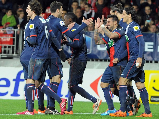 Paris Saint-Germain's Argentine forward Ezequiel Lavezzi celebrates with teammates after scoring his team's fifth goal during the French League Cup football match against Brest on January 8, 2014