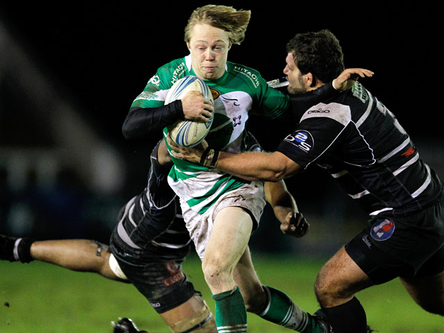 Newcastle Falcons' Joel Hodgson is tackled by Brive's Apisai Naikatini and Johannes Coetzee during their Challenge Cup match on January 9, 2014