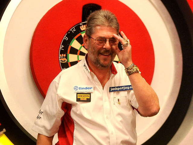 Martin Adams of England smiles after winning against David Cameron of Canada on day one of the BDO Lakeside World Professional Darts Championships at Lakeside Complex on January 4, 2014