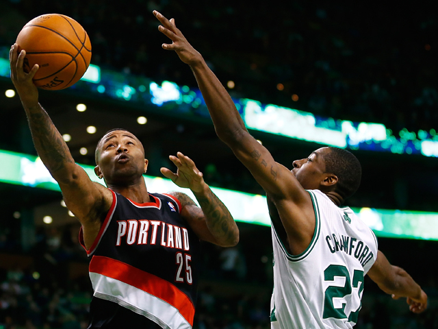 Mo Williams #25 of the Portland Trailblazers drives to the basket in front of Jordan Crawford #27 of the Boston Celtics in the second half during the game at TD Garden on November 15, 2013