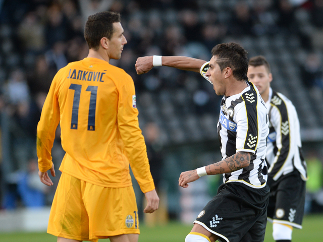 Roberto Pereyra of Udinese Calcio celebrates after scoring their first goal during the Serie A match between Udinese Calcio and Hellas Verona FC at Stadio Friuli on January 6, 2014