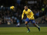 Arsenal's English midfielder Alex Oxlade-Chamberlain in action during an English Premier League football match between Aston Villa and Arsenal at Villa Park in Birmingham on January 13, 2014