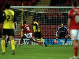 Watford's Lewis McGugan scores his team's second goal against Bristol City during their FA Cup third round replay match on January 14, 2014