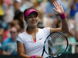 Li Na celebrates after her win over Katerina Makarova in their Australian Open fourth round match on January 19, 2014