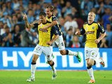 Central Coast Mariners' Mile Sterjovski celebrates with teammates after scoring the opening goal against Sydney on January 18, 2014