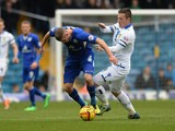 Leeds' Ross McCormack and Leicester's Paul Konchesky in action during their Championship match on January 18, 2014