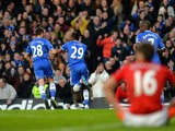 Chelsea's Samuel Eto'o celebrates with teammate Cesar Azpilicueta after scoring his team's opening goal against Man United during their Premier League match on January 19, 2014