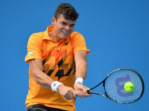 Canada's Milos Raonic plays a shot during his men's singles match against Romania's Victor Hanescu on day four of the 2014 Australian Open tennis tournament in Melbourne on January 16, 2014