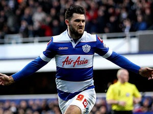 QPR's Charlie Austin celebrates after scoring the opening goal against Huddersfield during their Championship match on January 18, 2014