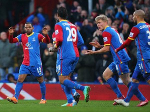 Jason Puncheon of Crystal Palace celebrates scoring the opening goal with team mates during the Barclays Premier League match against Stoke City on January 18, 2014