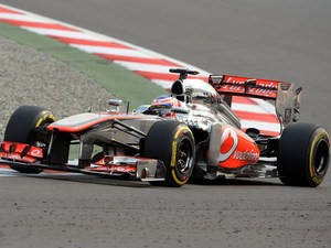 Jensen Button of McLaren drives during a practise session for the Indian Formula One Grand Prix on October 26, 2013