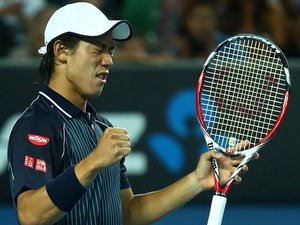 Kei Nishikori celebrates victory over Donald Young during their Australian Open third round match on January 18, 2014
