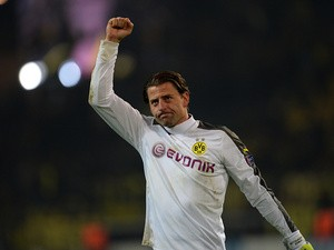 Dortmund's Roman Weidenfeller celebrates his team's win against Napoli during their Champions League match on November 26, 2013