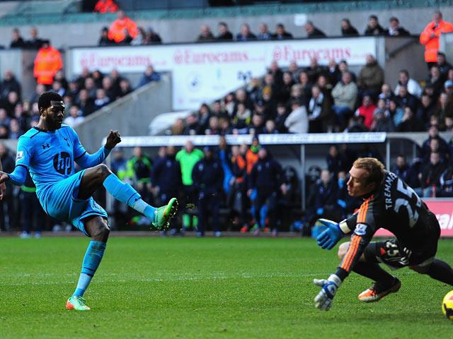 Tottenham's Emmanuel Adebayor scores his team's third goal against Swansea during their Premier League match on January 19, 2014