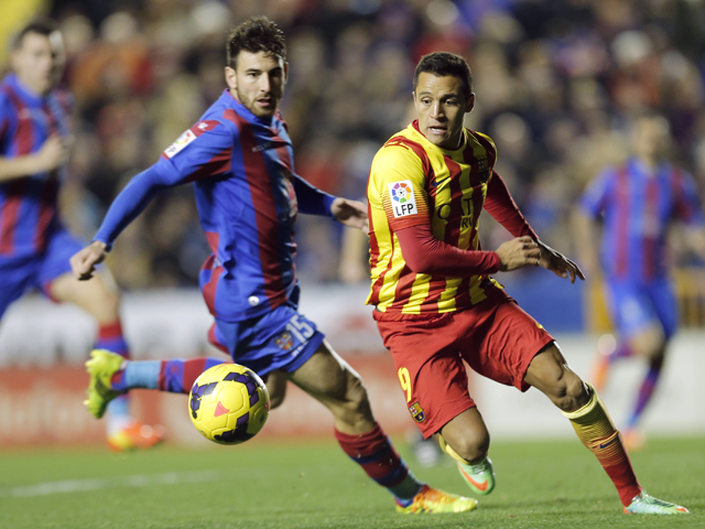 Barcelona's Chilean forward Alexis Sanchez vies with Levante's Greek defender Nikos Karampelas during the Spanish league football match Levante UD vs FC Barcelona at the Ciutat de Valencia Stadium in Valencia on January 19, 2014
