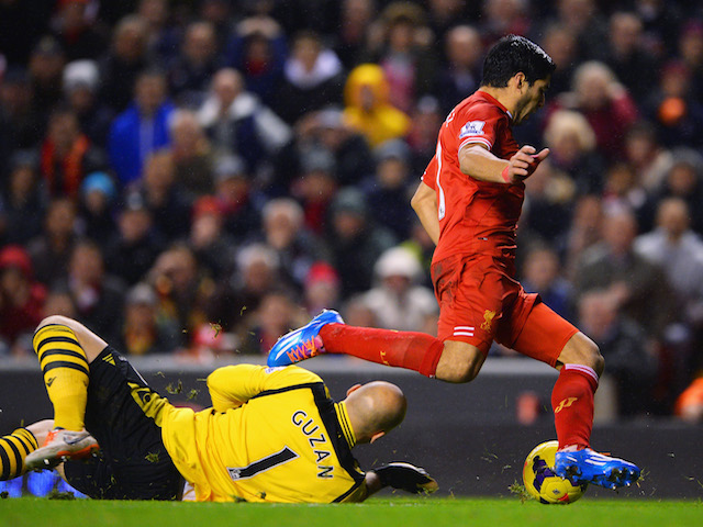 Luis Suarez of Liverpool goes to ground after a challenge by Brad Guzan of Aston Villa leading to a penalty during the Barclays Premier League match on January 18, 2014