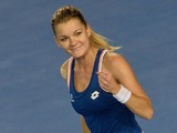 Poland's Agnieszka Radwanska celebrates after victory in her women's singles match against Spain's Garbine Muguruza on day eight of the 2014 Australian Open tennis tournament in Melbourne on January 20, 2014