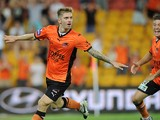 Luke Brattan of the Roar celebrates a goal during the round 16 A-League match between Brisbane Roar and the Wellington Phoenix at Suncorp Stadium on January 24, 2014