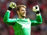 David de Gea celebrates a Manchester United goal on August 11, 2013.