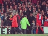 Eric Cantona is guided away after assaulting a Crystal Palace fan on January 25, 1995.