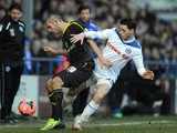 Ian Henderson of Rochdale in action with Joe Mattock of Sheffield Wednesday during the FA Cup with Budweiser Fourth Round match on January 25, 2014