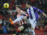 Athletic Bilbao's Kike Sola and Real Valladolid's Oscar Gonzalez in action during their La Liga match on January 20, 2014