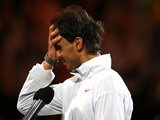 Rafael Nadal of Spain looks on after losing his men's final match against Stanislas Wawrinka of Switzerland during day 14 of the 2014 Australian Open on January 26, 2014