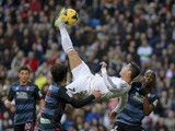 Real Madrid's Portuguese forward Cristiano Ronaldo kicks the ball during the Spanish league football match Real Madrid vs FC Granada at the Santiago Bernabeu stadium in Madrid on January 25, 2014