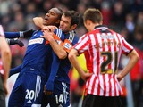 Hugo Rodallega of Fulham celebrates with Giorgos Karagounis as he scores their first goal during the FA Cup with Budweiser fourth round match between Sheffield United and Fulham at Bramall Lane on January 26, 2014