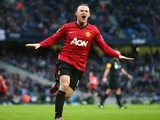 Wayne Rooney celebrates scoring against Manchester City on December 09, 2012.