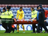 Jonathan Parr of Crystal Palace leaves the field on a stretcher during the Budweiser FA Cup fourth round match between Wigan Athletic and Crystal Palace at DW Stadium on January 25, 2014