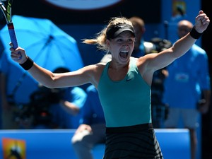 Canada's Eugenie Bouchard celebrates after victory in her women's singles match against Serbia's Ana Ivanovic on day nine at the 2014 Australian Open tennis tournament in Melbourne on January 21, 2014