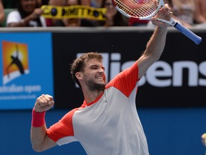Grigor Dimitrov of Bulgaria celebrates his win over Roberto Bautista Agut of Spain following their men's singles match on day eight of the 2014 Australian Open tennis tournament in Melbourne on January 20, 2014