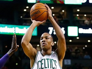 Avery Bradley of the Boston Celtics takes a shot against the Los Angeles Lakers in the first quarter during the game at TD Garden on January 17, 2014